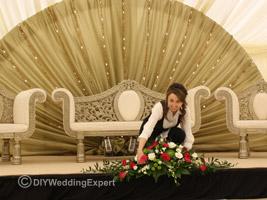 setting up wedding decorations at an asian wedding