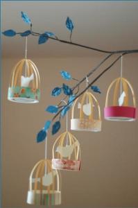 an idea for a diy wedding centerpiece featuring birdcades