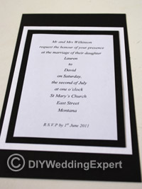 mounting for a black and white wedding invitation