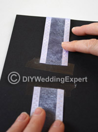 ribbon detailing for a black and white wedding invitation