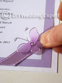 adding butterflies to a wedding invitation