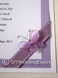purple butterfly on a diy wedding invitation