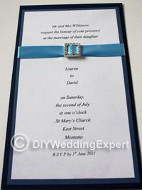 diy wedding invitation featuring a diamante buckle