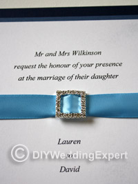 diamate buckle on a diy wedding invitation
