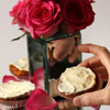 a diy wedding cup cake stand decorated with rose petals