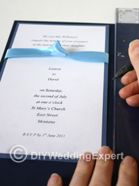 blue card for a diy wedding invitation