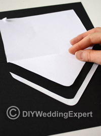 cutting your diy wedding invitation envelopes