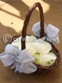 grey bows on flower girl petal baskets for a wedding