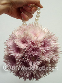 flower kissing ball with a pearl bead handle for a flower girl