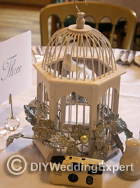 bird cage used as homemade wedding centerpiece