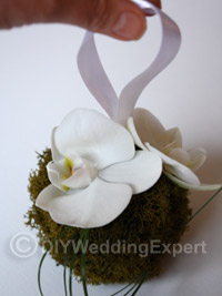 pomander ball for a flower girl at a winter wedding