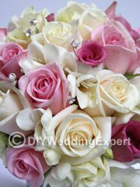 brides wedding bouquet in soft pastel colors