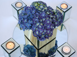 a mass of blue hydrangea flowers used to create a wedding centerpiece