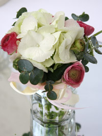 flowers in a jam jar to create a vintage style wedding centerpiece