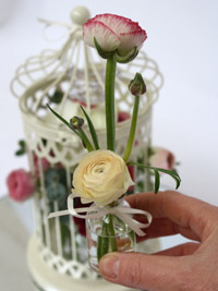 ranunculus flowers in a wedding centerpiece