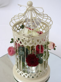 flowers in a wedding bird cage centerpiece