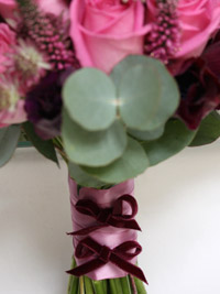 velvet ribbon bow detailing on a posy bouquet handle