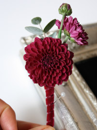 a buttonhole finished with velvet ribbon detailing