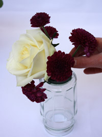 adding wedding flowers into floristry foam