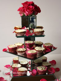 a diy wedding cupcake stand made from square mirrors