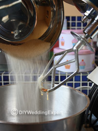 adding sugar to the mixer when making wedding cupcakes