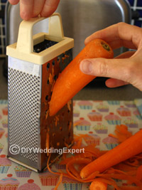 grating carrots for carrot cupcakes