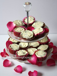 diy wedding cupcakes arranged on a vintage cake stand