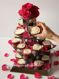 diy wedding cupcakes arranged on a mirror cake stand