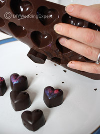 heart chocolates being made as diy wedding favors