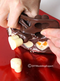 releasing white chocolate favors from a mould