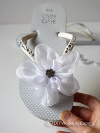 bridal flip flops decorated with a flower