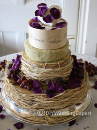 a tired cheese wedding cake for a wedding with a purple colour theme