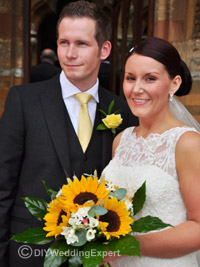 bride carrying a bouquet made from sunflowers for a yellow wedding theme