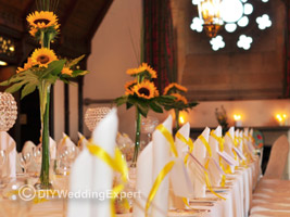 tall sunflower centerpieces for a yellow wedding theme