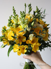 a bridal bouquet created out of natural yellow flowers