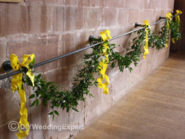 leaf swags with yellow bows for a wedding decoration